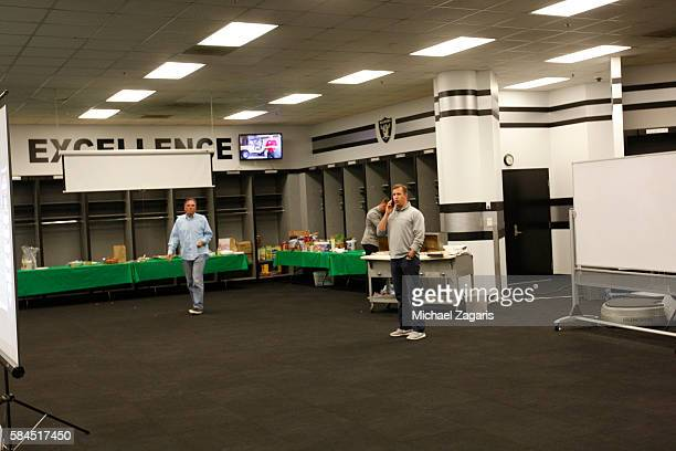 General Manager David Forst of the Oakland Athletics makes a phone call before selected the teams first pick in the war room during the first day of...