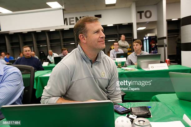 General Manager David Forst of the Oakland Athletics sits in the war room during the first day of the 2016 MLB Draft at the Oakland Coliseum on June...