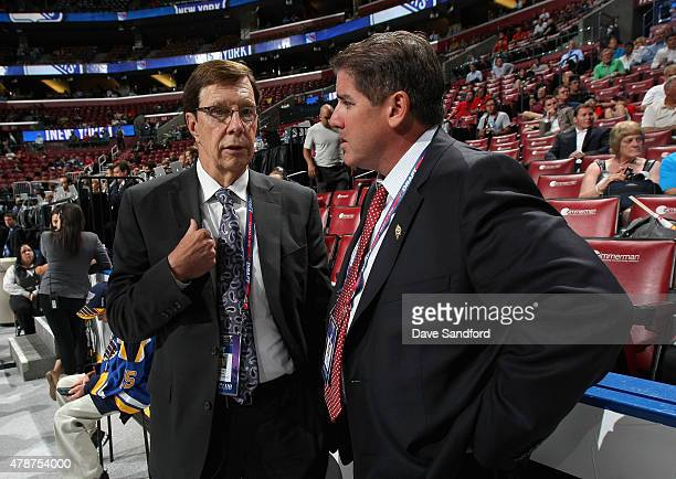 General Manager David Poile and head coach Peter LaViolette of the Nashville Predators talk on the draft floor during the 2015 NHL Draft at BB&T...