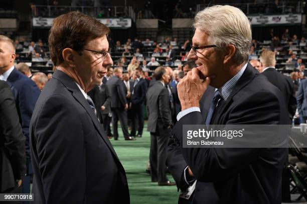 General manager David Poile of the Nashville Predators speaks with player scout Larry Pleau of the St. Louis Blues during the first round of the 2018...