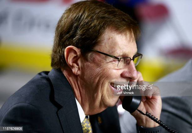 General manager David Poile of the Nashville Predators talks on the phone during Rounds 2-7 of the 2019 NHL Draft at Rogers Arena on June 22, 2019 in...