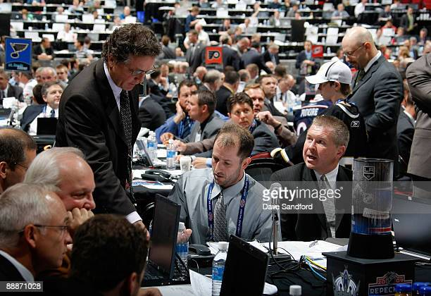 General Manager Dean Lombardi of the Los Angeles Kings go over notes with Michael Futa and Mark Yannetti during the second day of the 2009 NHL Entry...
