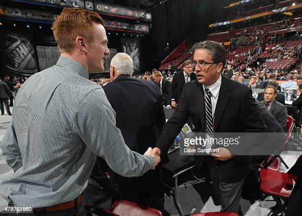 General Manager Dean Lombardi of the Los Angeles Kings shakes the hand of 99th overall pick by the Los Angeles Kings Austin Wagner during the 2015...