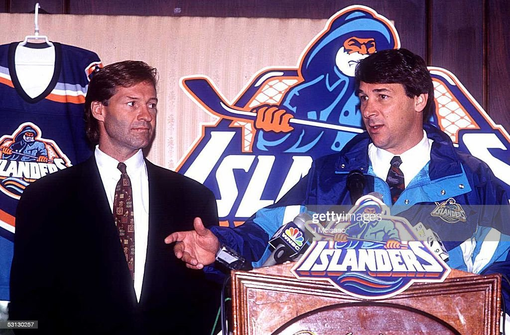 General manager Don Maloney of the New York Islander introduces new head coach Mike Milbury during a press conference on July 5, 1995 at the Nassau Coliseum in Uniondale, New York.