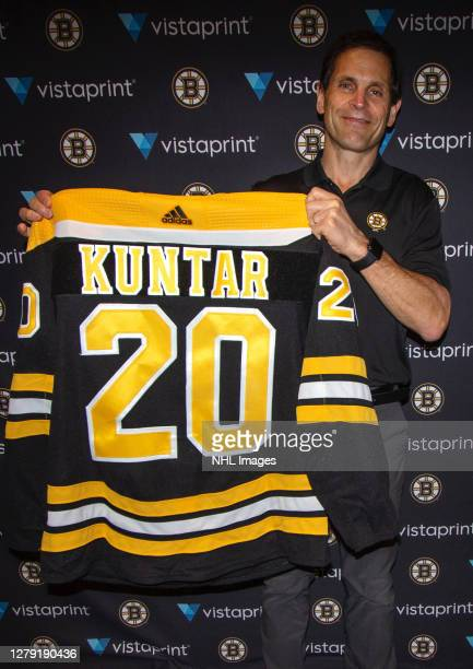 General manager Don Sweeney of the Boston Bruins holds up the jersey of their 89th overall pick Trevor Kuntar during round three of the 2020 NHL...