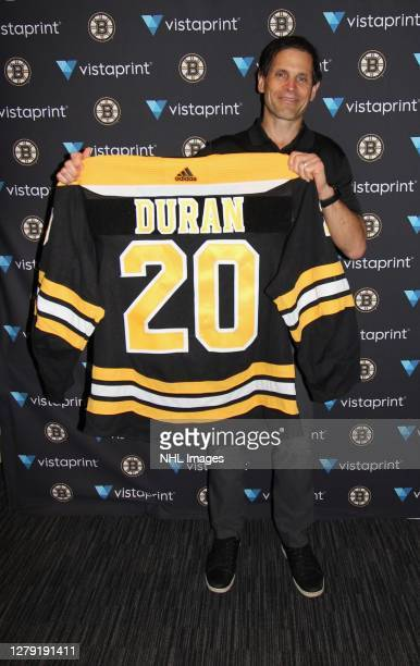 General manager Don Sweeney of the Boston Bruins holds up the jersey of their 182nd overall pick Riley Duran during round six of the 2020 NHL Entry...