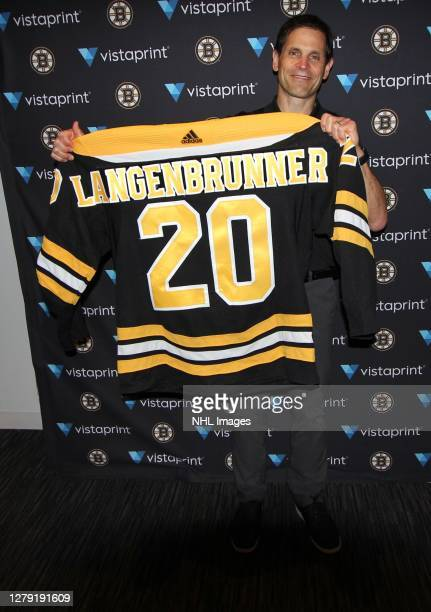 General manager Don Sweeney of the Boston Bruins holds up the jersey of their 151st overall pick Mason Langenbrunner during round six of the 2020 NHL...