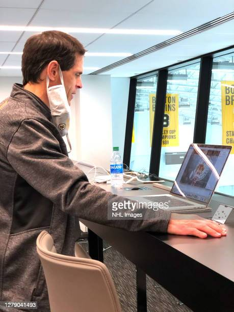 General manager Don Sweeney of the Boston Bruins speaks to the 58th overall pick Mason Lohrei on a zoom call during rounds 27 of the 2020 NHL Entry...
