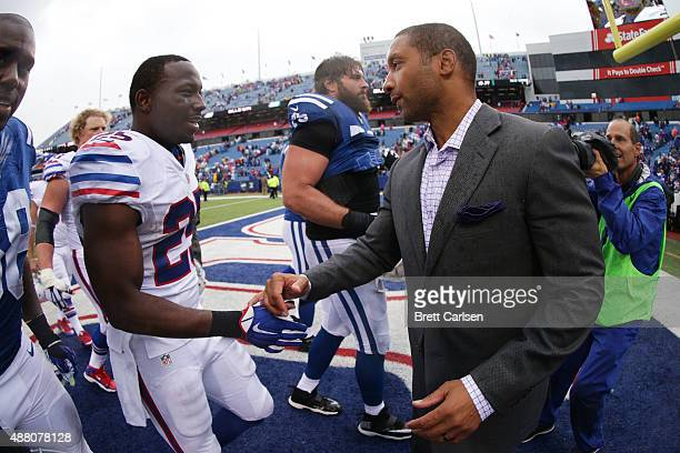 General Manager Doug Whaley congratulates LeSean McCoy of the Buffalo Bills after the game against the Indianapolis Colts at Ralph Wilson Stadium on...