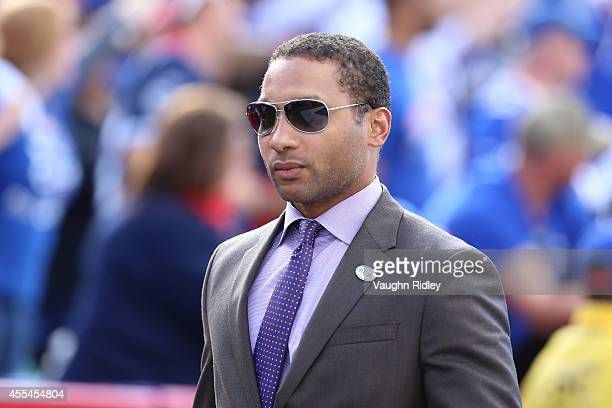 General Manager Doug Whaley of the Buffalo Bills walks off the field after beating the Miami Dolphins at Ralph Wilson Stadium on September 14 2014 in...