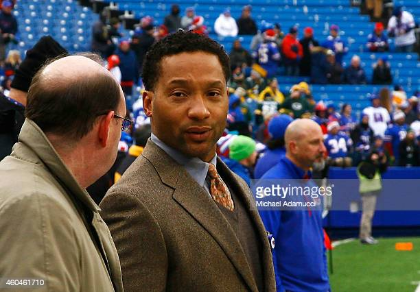 General Manager Doug Whaley of the Buffalo Bills watches warm ups before the game against the Green Bay Packers at Ralph Wilson Stadium on December...