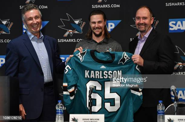 General Manager Doug Wilson Erik Karlsson and head coach Peter DeBoer of the San Jose Sharks pose for a photo during a press conference at the Hilton...