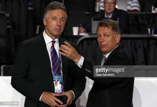 General manager Doug Wilson of the San Jose Sharks and general manager Ken Holland of the Edmonton Oilers talk on the draft floor during Rounds 27 of...