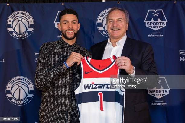 General Manager Ernie Grunfeld poses for a photo with Austin Rivers of the Washington Wizards during a press conference at Capital One Arena in...