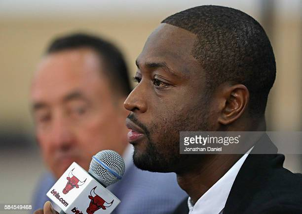 General manager Gar Forman of the Chicago Bulls listens as Dwyane Wade speaks during an introductory press conference at the Advocate Center on July...