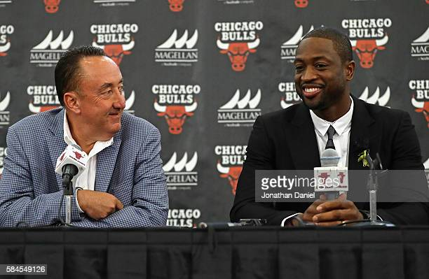 General manager Gar Forman of the Chicago Bulls presents new Bull at Dwyane Wade an introductory press conference at the Advocate Center on July 29...