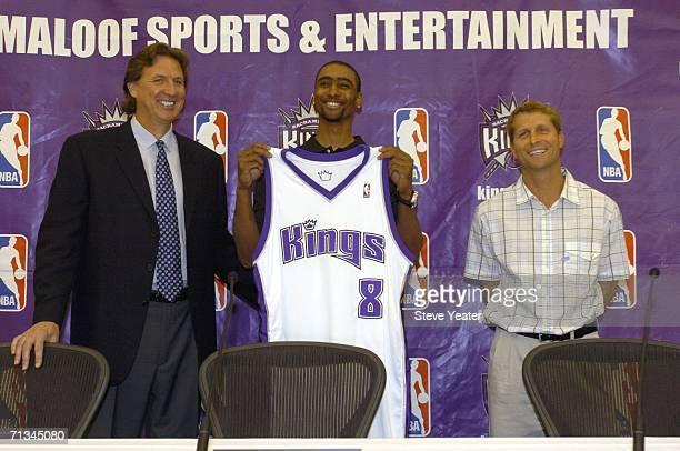 General manager Geoff Petrie first round draft pick Quincy Douby and head coach Eric Musselman of the Sacramento Kings pose together during a press...
