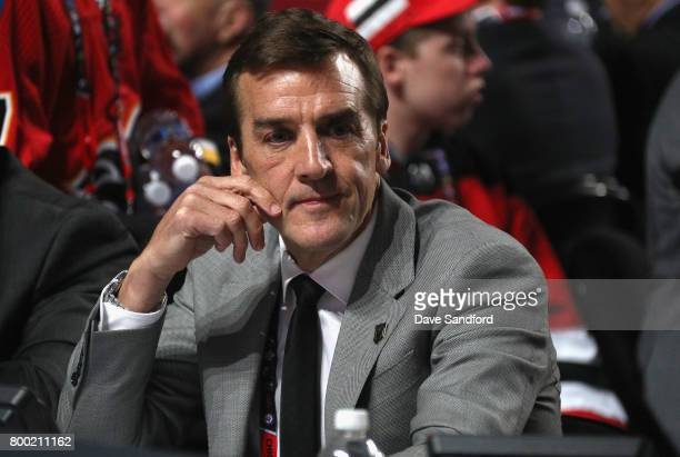 General manager George McPhee of the Vegas Golden Knights looks on from the draft floor table during Round One of the 2017 NHL Draft at United Center...