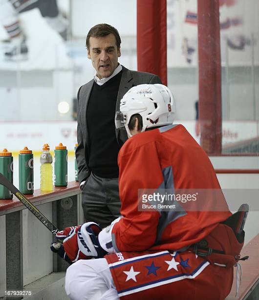 General Manager George McPhee speaks with Alex Ovechkin of the Washington Capitals at the Kettler Capitals Iceplex on February 23 2013 in Arlington...