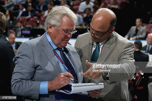 General Manager Glen Sather of the New York Rangers confers with gerenal manager Peter Chiarelli of the Edmonton Oilers on the draft floor during the...