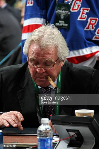 General Manager Glen Sather of the New York Rangers sits at the Rangers draft table during day one of the 2011 NHL Entry Draft at Xcel Energy Center...