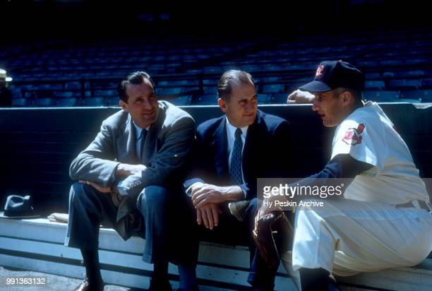 General Manager Hank Greenberg and Al Rosen of the Cleveland Indians talk with an unidentified man before an MLB game against the Chicago White Sox...