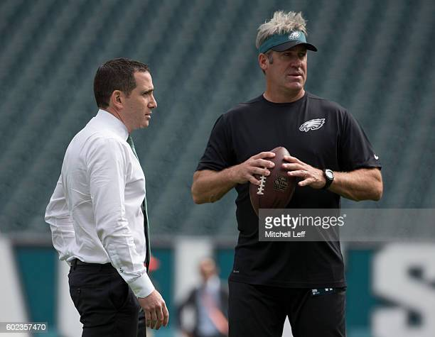 General manager Howie Roseman and head coach Doug Pederson of the Philadelphia Eagles look on prior to the game against the Cleveland Browns at...