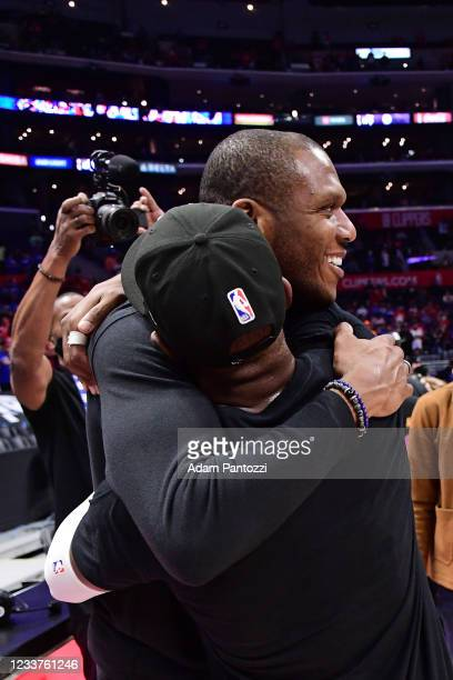General Manager, James Jones hugs Chris Paul of the Phoenix Suns after the game against the LA Clippers during Game 6 of the Western Conference...