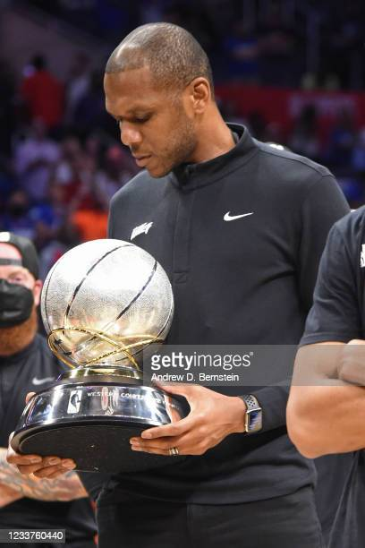 General Manager, James Jones of the Phoenix Suns holds the Western Conference Finals Trophy after the game against the LA Clippers during Game 6 of...