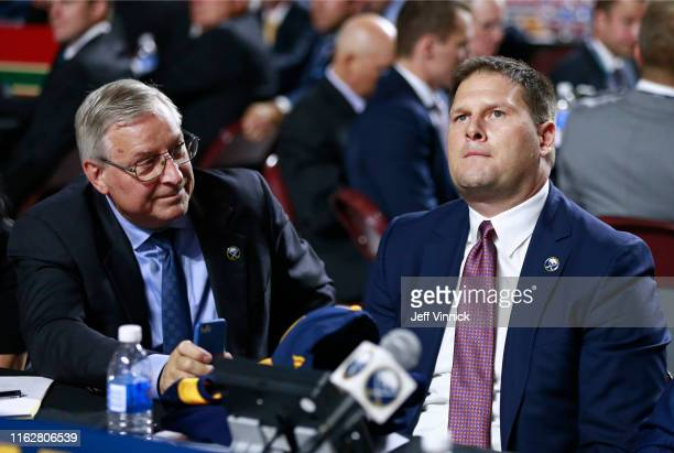 General manager Jason Botterill of the Buffalo Sabres looks on from the team draft table during the first round of the 2019 NHL Draft at Rogers Arena...