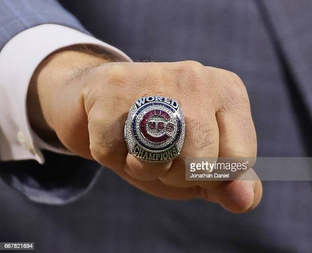 General manager Jed Hoyer of the Chicago Cubs show off the World Series Championship ring before a game against the Los Angeles Dodgers at Wrigley...