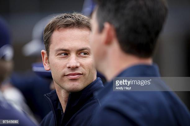 General Manager Jed Hoyer of the San Diego Padres watches practice during photo media day at the Padres spring training complex on February 27, 2010...