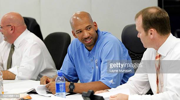General Manager Jeff Bower and Head Coach Monty Williams and President Hugh Weber of the New Orleans Hornets prepare in the war room for the 2010 NBA...