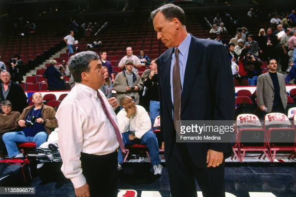 General Manager Jerry Krause of the Chicago Bulls speaks to Doug Collins before the game against the New York Knicks on April 18 1998 at the United...
