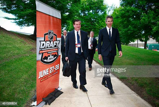 General Manager Jim Benning and President Trevor Linden of the Vancouver Canucks arrives for the 2014 NHL Entry Draft at Wells Fargo Center on June...
