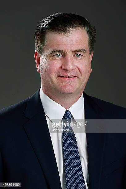 General Manager Jim Benning of the Vancouver Canucks poses for his official headshot for the 20142015 season on September 18 2014 at the Rogers Arena...
