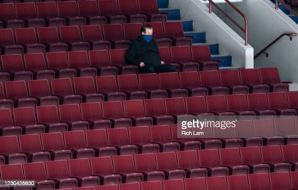 General Manager Jim Benning of the Vancouver Canucks takes in the second session on the first day of the Vancouver Canucks NHL Training Camp on...
