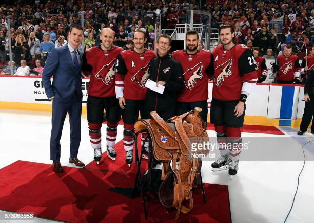 General Manager John Chayka Derek Stepan Alex Goligoski Brad Richardson and Oliver Ekman_larsson of the Arizona Coyotes stand with Head Equipment...