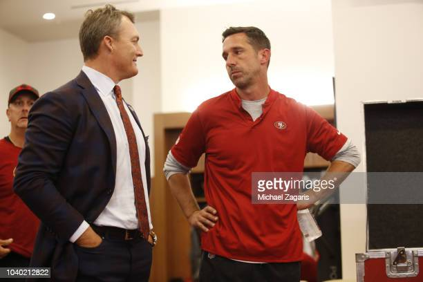 General Manager John Lynch and Head Coach Kyle Shanahan of the San Francisco 49ers talk in the locker room following the game against the Detroit...