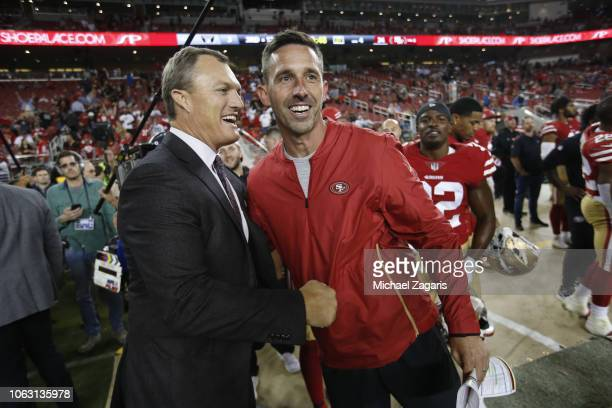 General Manager John Lynch and Head Coach Kyle Shanahan of the San Francisco 49ers embrace on the sideline during the final second of the game...