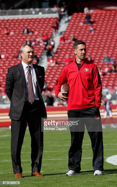 General Manager John Lynch and Head Coach Kyle Shanahan of the San Francisco 49ers stand on the field prior to the game against the Arizona Cardinals...
