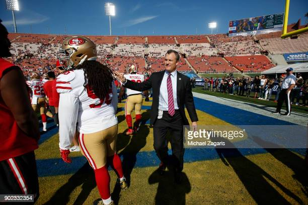 General Manager John Lynch of the San Francisco 49ers stands on the field prior to the game against the Los Angeles Rams at Los Angeles Memorial...