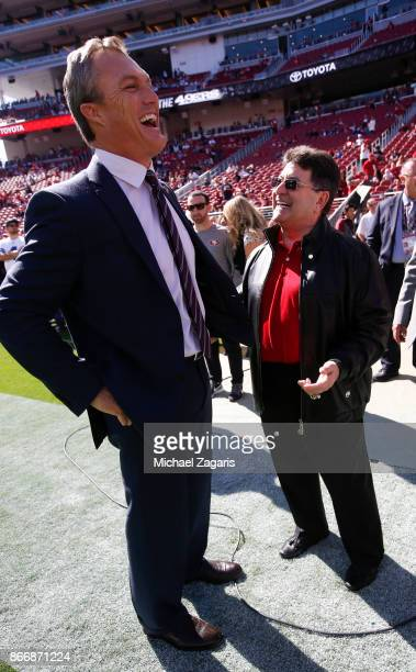 General Manager John Lynch of the San Francisco 49ers talks with Eddie DeBartolo Jr on the sideline prior to the game between the 49ers and the...