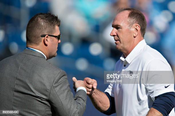 General Manager Jon Robinson bumps fist with Head Coach Mike Mularkey of the Tennessee Titans before a game against the Houston Texans at Nissan...