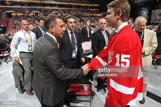 General Manager Ken Holland of the Detroit Red Wings shakes the hand of Vili Saarijarvi 73rd overall pick by the Detroit Red Wings during the 2015...