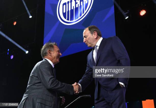 General Manager Ken Holland of the Edmonton Oilers is welcomed onstage by NHL Commissioner Gary Bettman during the first round of the 2019 NHL Draft...
