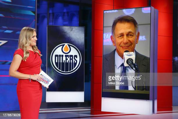 General manager Ken Holland of the Edmonton Oilers R is interviewed by Jamie Hersch of the NHL Network during the first round of the 2020 National...