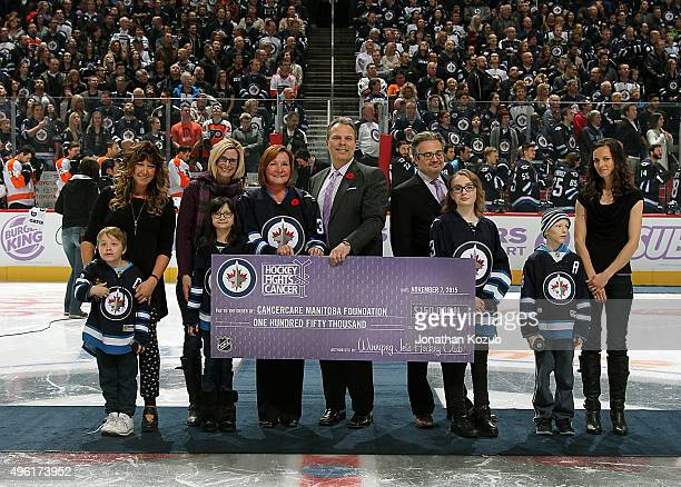 General Manager Kevin Cheveldayoff of the Winnipeg Jets presents a cheque to CancerCare Manitoba in honor of the Hockey Fights Cancer initiative...
