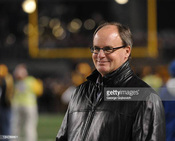 General Manager Kevin Colbert of the Pittsburgh Steelers smiles as he looks on from the sideline before a game against the Baltimore Ravens at Heinz...