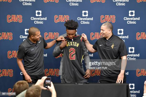 General manager Koby Altman and head coach Tyronn Lue of the Cleveland Cavaliers introduce Collin Sexton during a press conference on June 22 2018 at...